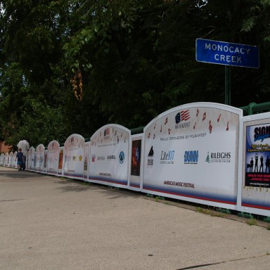 Sponsor signs along fence for festival