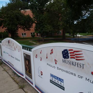 Sponsor signs along fence for festival
